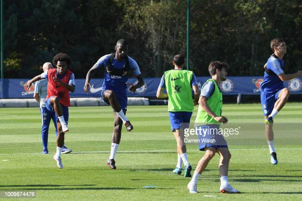 Willian and Antonio Rudiger of Chelsea warm up during a training session at Chelsea Training Ground on August 2 2018 in Cobham England