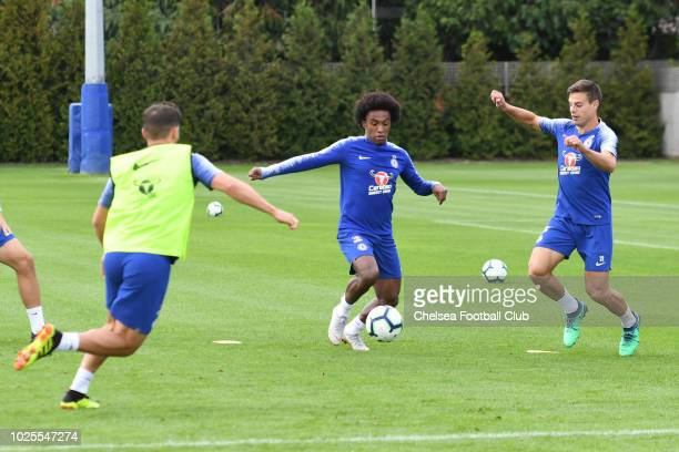 Willian and Cesar Azpilicueta of Chelsea during a training session at Chelsea Training Ground on August 31 2018 in Cobham England