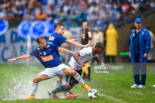 Willian and Everton Ribeiro of Cruzeiro and Thiago Mendes of Goias battle for the ball during a match between Cruzeiro and Goias as part of...