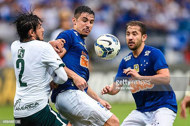 Willian and Everton Ribeiro of Cruzeiro and Tiago Real of Goias battle for the ball during a match between Cruzeiro and Goias as part of Brasileirao...