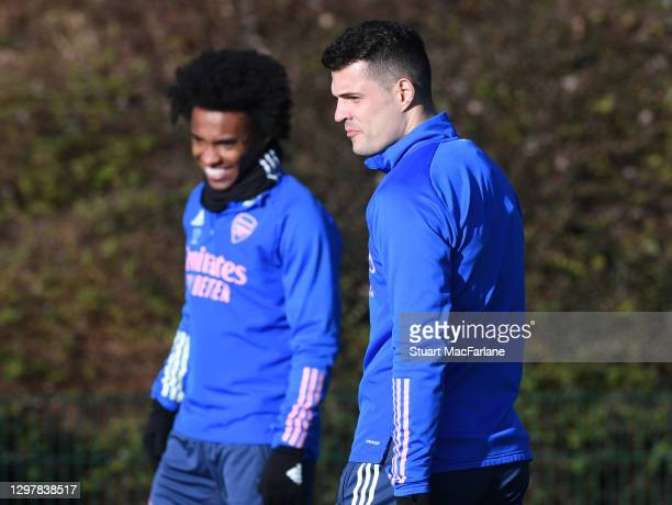 Willian and Granit Xhaka of Arsenal during a training session at London Colney on January 22, 2021 in St Albans, England.