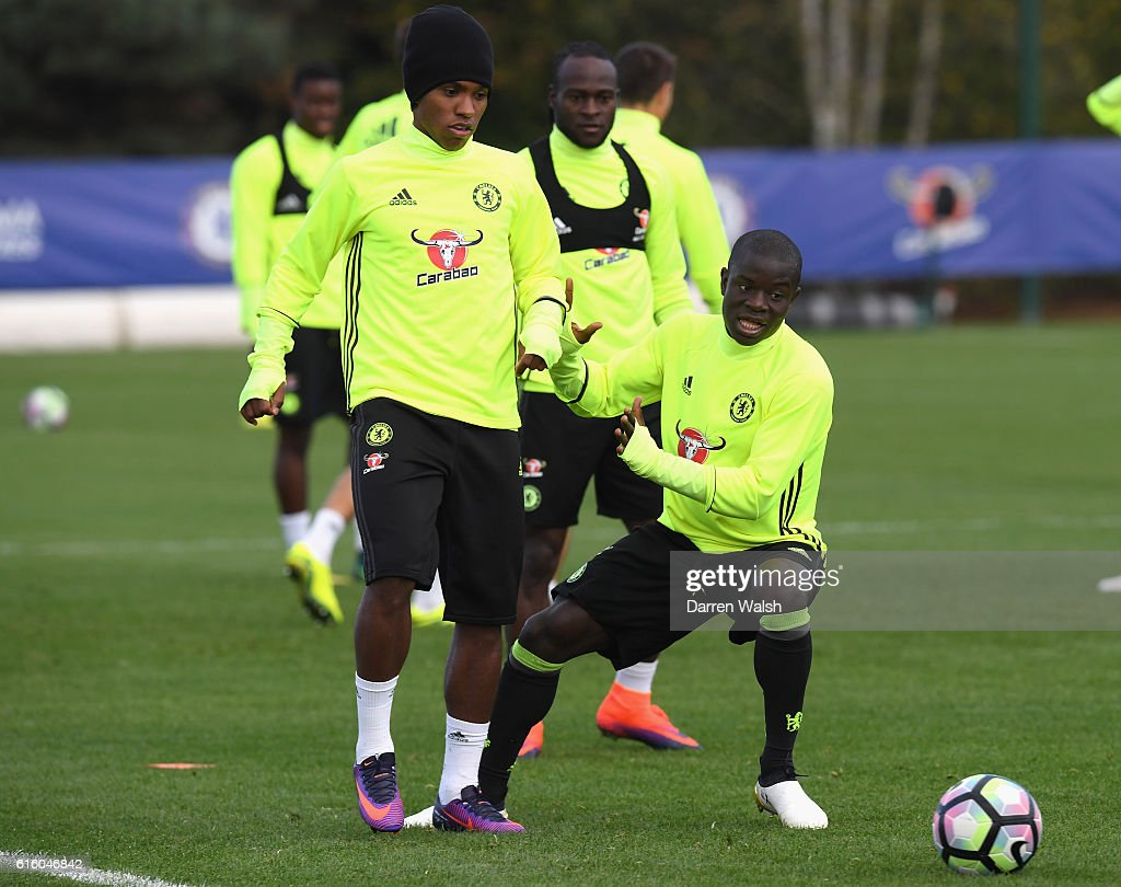 Willian and N'Golo Kante of Chelsea during a training session at Chelsea Training Ground on October 21, 2016 in Cobham, England.