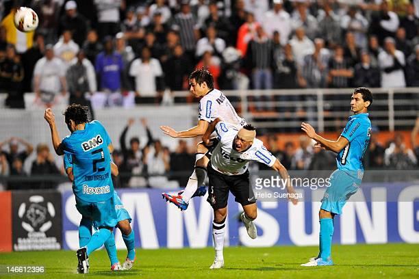Willian and Ralf of Corinthians celebrate a goal against Corinthians during a match between Corinthians and Santos as part of Santander Libertadores...