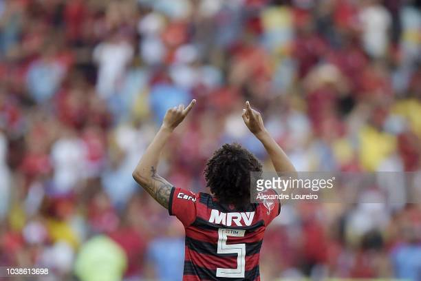 Lucas Paqueta of Flamengo struggles for the ball with José Welison of AtleticoMG during the match between Flamengo and AtleticoMG as part of...