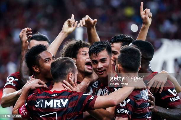 Willian Arao of Flamengo celebrates with a teammates after scoring the first goal during a match between Flamengo and Atletico MG as part of...