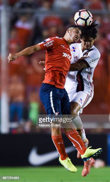 Willian Arao of Flamengo fights for ball with Ezequiel Barco of Independiente during the first leg of the Copa Sudamericana 2017 final between...