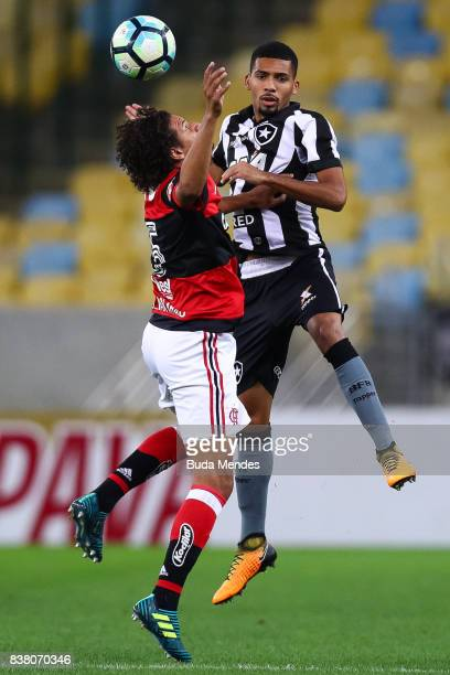 Willian Aro of Flamengo struggles for the ball with Matheus Fernandes of Botafogo during a match between Flamengo and Botafogo part of Copa do Brasil...