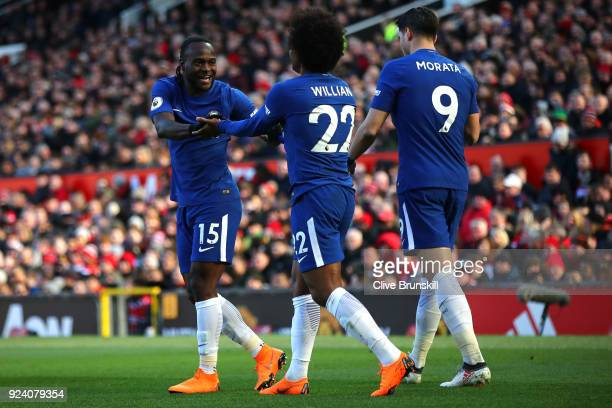 Willian celebrates after scoring his sides first goal with Victor Moses and Alvaro Morata of Chelsea during the Premier League match between...