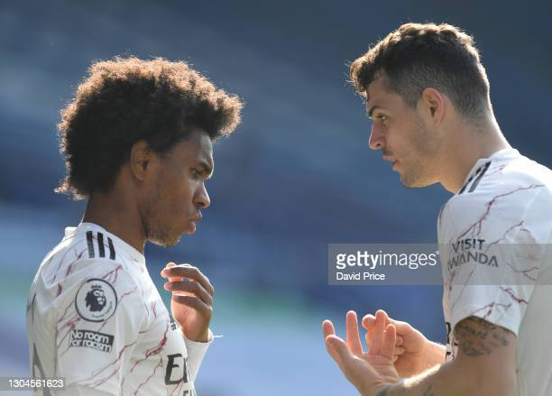 Willian gets some instructions from Granit Xhaka of Arsenal during the Premier League match between Leicester City and Arsenal at The King Power...