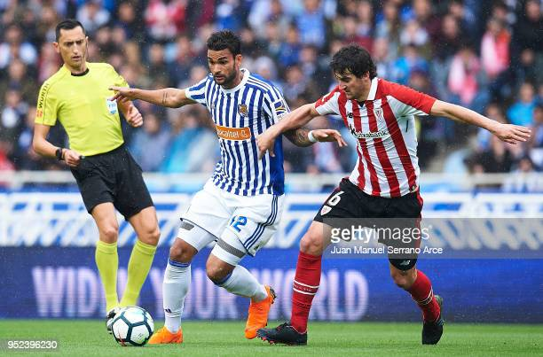 Willian Jose Da Silva of Real Sociedad competes for the ball with Mikel San Jose of Athletic Club during the La Liga match between Real Sociedad and...