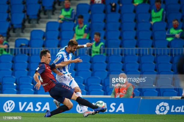 Willian Jose of Real Sociedad and Unai Garcia of Osasuna competes for the ball during the Liga match between Real Sociedad and CA Osasuna at Estadio...