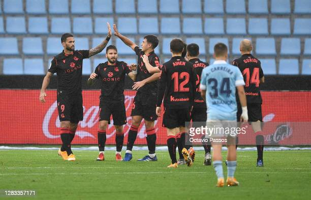 Willian Jose of Real Sociedad celebrates with teammates after scoring his sides third goal during the La Liga Santander match between RC Celta and...