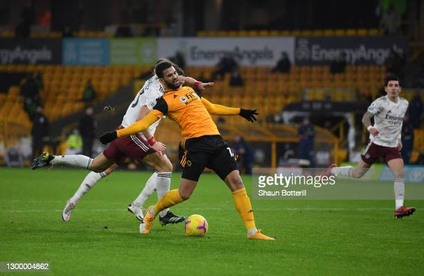 Willian Jose of Wolverhampton Wanderers is fouled by David Luiz of Arsenal in the box which later leads to a penalty during the Premier League match...