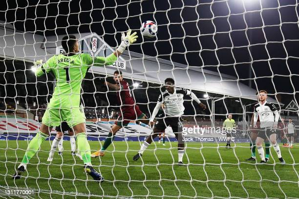 Willian Jose of Wolverhampton Wanderers scores his team's first goal which is later disallowed by VAR for an offside on Daniel Podence of...