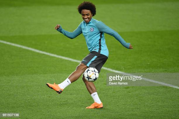 Willian juggles the ball during a Chelsea training session on the eve of their UEFA Champions League round of 16 match against FC Barcelona at Nou...