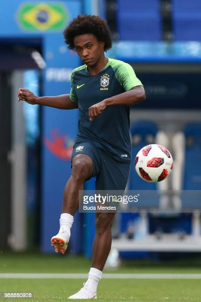 Willian kicks the ball during a Brazil training session ahead of the Round 16 match against Mexico at Samara Arena on July 1 2018 in Samara Russia