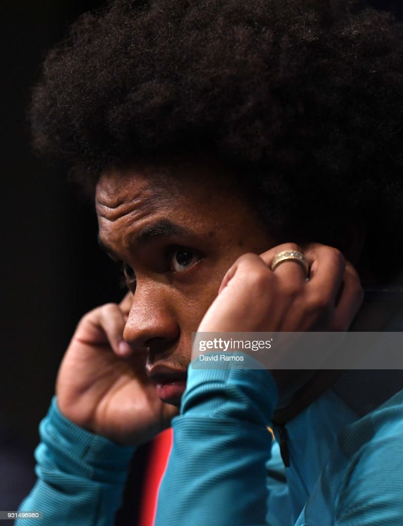 Willian looks on during a Chelsea press conference on the eve of their UEFA Champions League round of 16 match against FC Barcelona at Nou Camp on March 13, 2018 in Barcelona, Spain.
