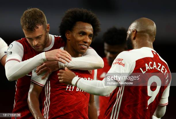 Willian of Arsenal celebrates with Alexandre Lacazette after scoring their side's third goal during the Premier League match between Arsenal and West...
