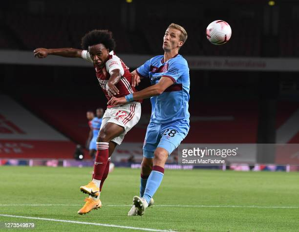 Willian of Arsenal challenged by Tomas Soucek of West Ham during the Premier League match between Arsenal and West Ham United at Emirates Stadium on...