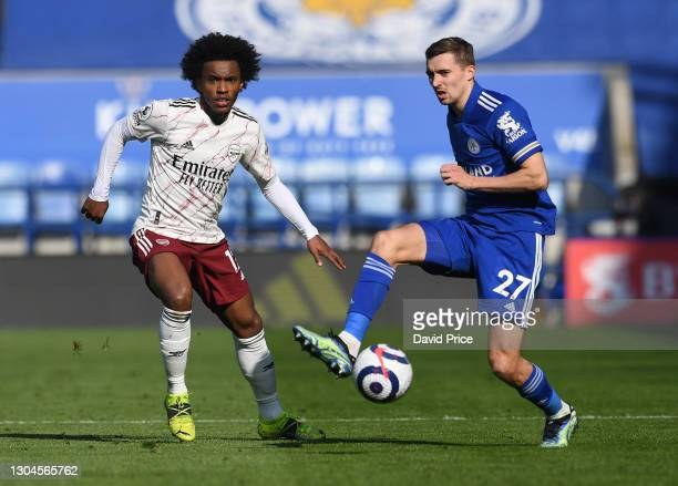 Willian of Arsenal is challenged by Timothy Castagne of Leicester during the Premier League match between Leicester City and Arsenal at The King...