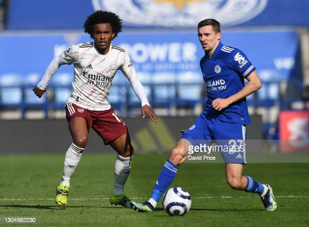 Willian of Arsenal is closed down by Timothy Castagne of Leicester during the Premier League match between Leicester City and Arsenal at The King...