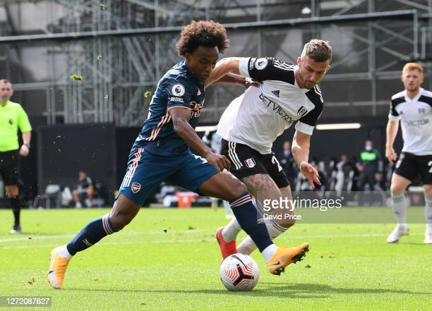 Willian of Arsenal takes on Joe Bryan of Fulham during the Premier League match between Fulham and Arsenal at Craven Cottage on September 12 2020 in...