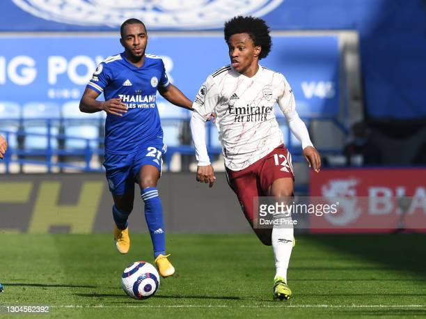 Willian of Arsenal takes on Ricardo Pereira of Leicester during the Premier League match between Leicester City and Arsenal at The King Power Stadium...