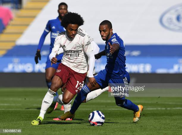 Willian of Arsenal takes on Ricardo Periera of Leicester during the Premier League match between Leicester City and Arsenal at The King Power Stadium...