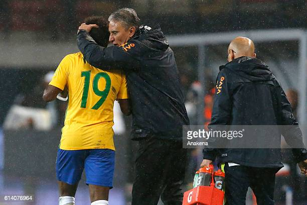 Willian of Brazil celebrates with his coach Tite after scoring the second goal of his team during a match between Venezuela and Brazil as part of...