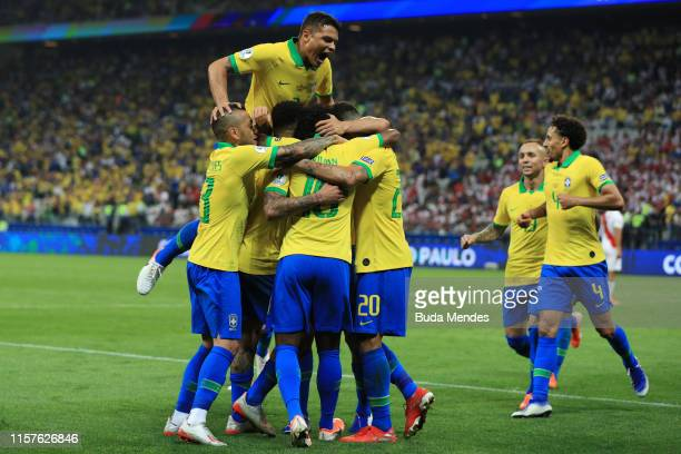 Willian of Brazil celebrates with teammates after scoring the fifth goal of his team during the Copa America Brazil 2019 group A match between Peru...