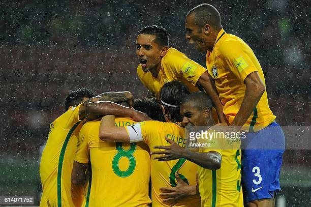 Willian of Brazil celebrates with teammates after scoring the second goal of his team during a match between Venezuela and Brazil as part of FIFA...