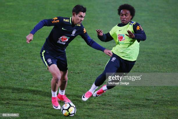 Willian of Brazil chases the ball contolled by a Melbourne Victory listed player during a Brazil training session at Lakeside Stadium on June 6 2017...