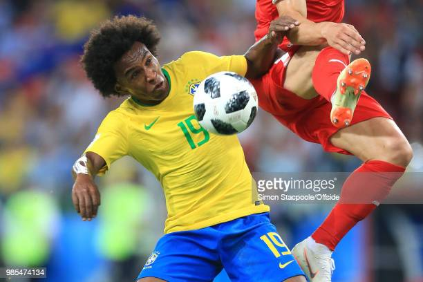 Willian of Brazil comes close to the boots of Filip Kostic of Serbia during the 2018 FIFA World Cup Russia Group E match between Serbia and Brazil at...