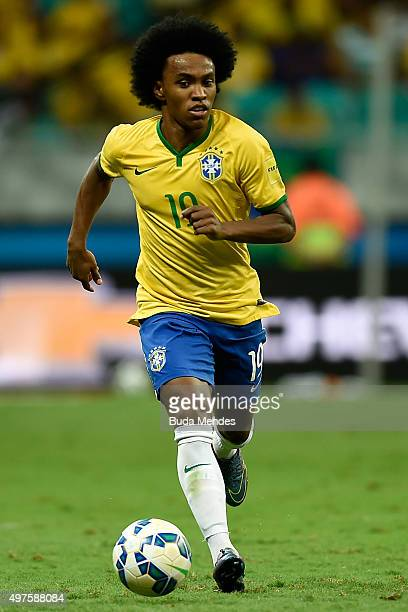 Willian of Brazil controls the ball with of Peru during a match between Brazil and Peru as part of 2018 FIFA World Cup Russia Qualifiers at Arena...