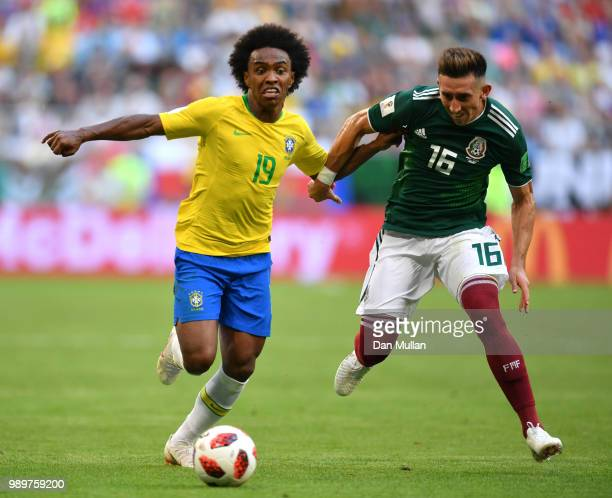Willian of Brazil is challenged by Hector Herrera of Mexico during the 2018 FIFA World Cup Russia Round of 16 match between Brazil and Mexico at...