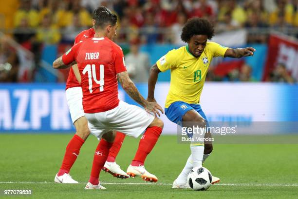 Willian of Brazil is challenged by Steven Zuber of Switzerland during the 2018 FIFA World Cup Russia group E match between Brazil and Switzerland at...