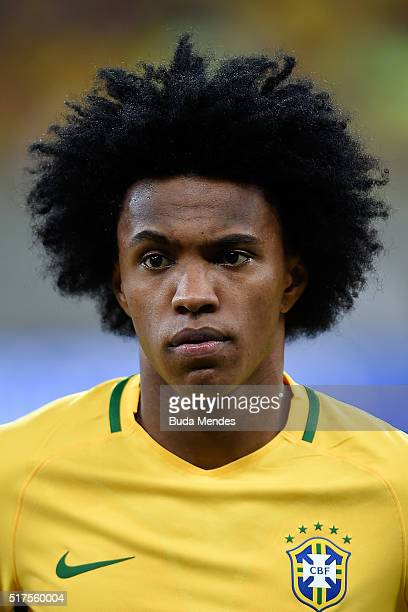Willian of Brazil looks on during a match between Brazil and Uruguay as part of 2018 FIFA World Cup Russia Qualifiers at Arena Pernanbuco on March 25...