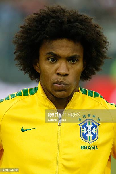 Willian of Brazil looks on during the national anthem ceremony prior the 2015 Copa America Chile Group C match between Brazil and Venezuela at...