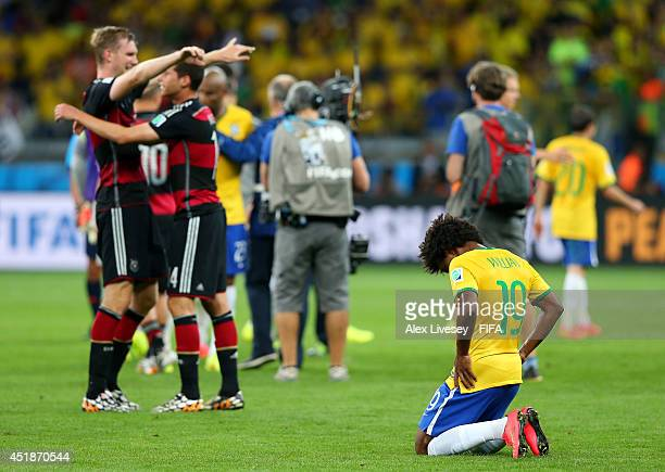 Willian of Brazil reacts after the 17 defeat in the 2014 FIFA World Cup Brazil Semi Final match between Brazil and Germany at Estadio Mineirao on...