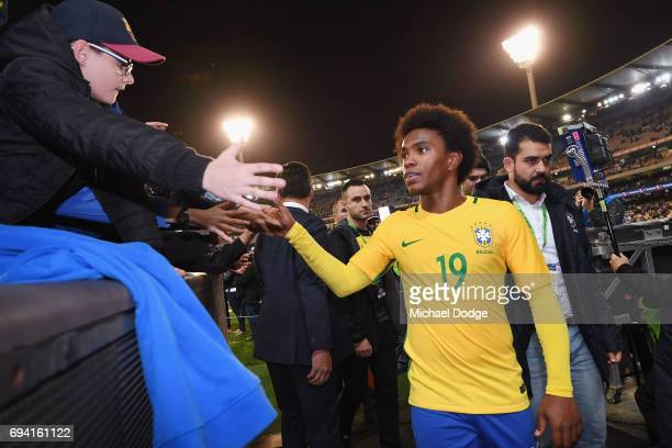 Willian of Brazil says goodbye to fans during the Brasil Global Tour match between Brazil and Argentina at Melbourne Cricket Ground on June 9 2017 in...