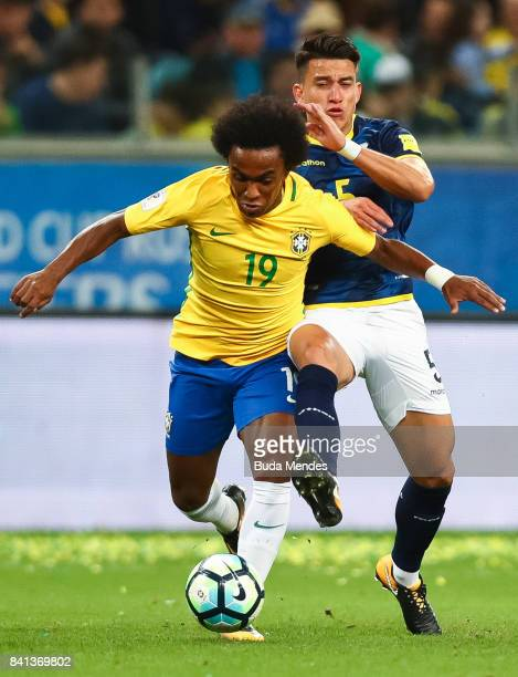 Willian of Brazil struggles for the ball with Fernando Gaibor of Ecuador during a match between Brazil and Ecuador as part of 2018 FIFA World Cup...