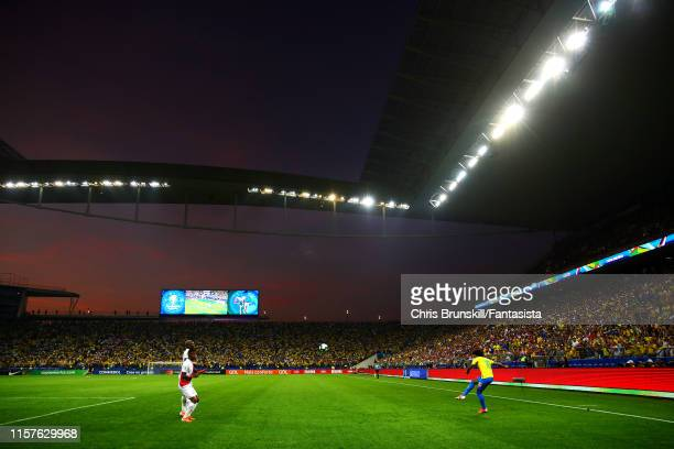 Willian of Brazil takes a free-kick during the Copa America Brazil 2019 group A match between Peru and Brazil at Arena Corinthians on June 22, 2019...