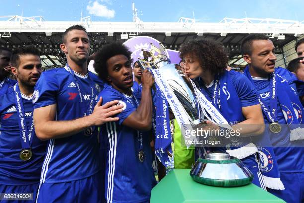 Willian of Chelsea and David Luiz of Chelsea celebrate with the Premier League Trophy after the Premier League match between Chelsea and Sunderland...