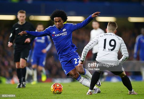 Willian of Chelsea and Gerard Deulofeu of Everton compete for the ball during the Barclays Premier League match between Chelsea and Everton at...