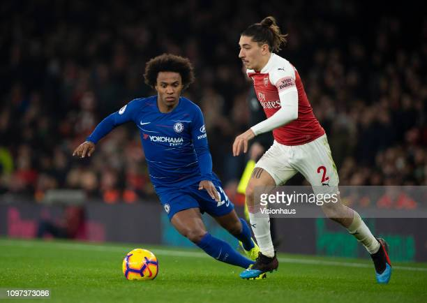 Willian of Chelsea and Héctor Bellerín of Arsenal during the Premier League match between Arsenal FC and Chelsea FC at Emirates Stadium on January 19...