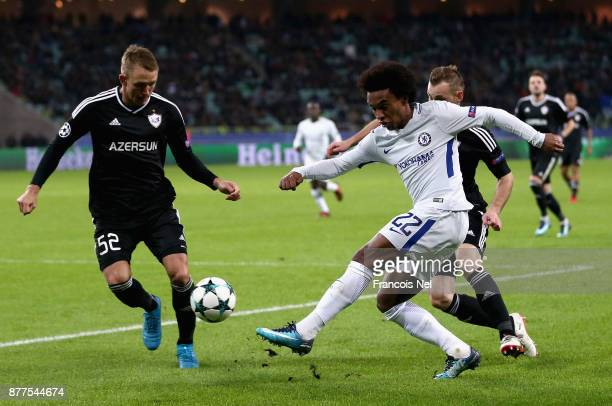 Willian of Chelsea and Jakub Rzezniczak of Qarabag FK battle for possession during the UEFA Champions League group C match between Qarabag FK and...