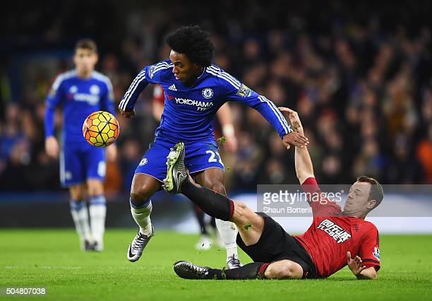 Willian of Chelsea and Jonny Evans of West Bromwich Albion compete for the ball during the Barclays Premier League match between Chelsea and West...