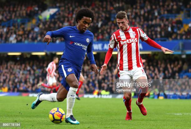 Willian of Chelsea and Josh Tymon of Stoke City battle for possession during the Premier League match between Chelsea and Stoke City at Stamford...