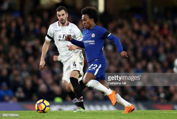 Willian of Chelsea and Luka Milivojevic of Crystal Palace during the Premier League match between Chelsea and Crystal Palace at Stamford Bridge on...