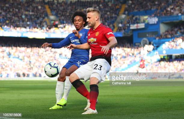Willian of Chelsea and Luke Shaw of Manchester United during the Premier League match between Chelsea FC and Manchester United at Stamford Bridge on...